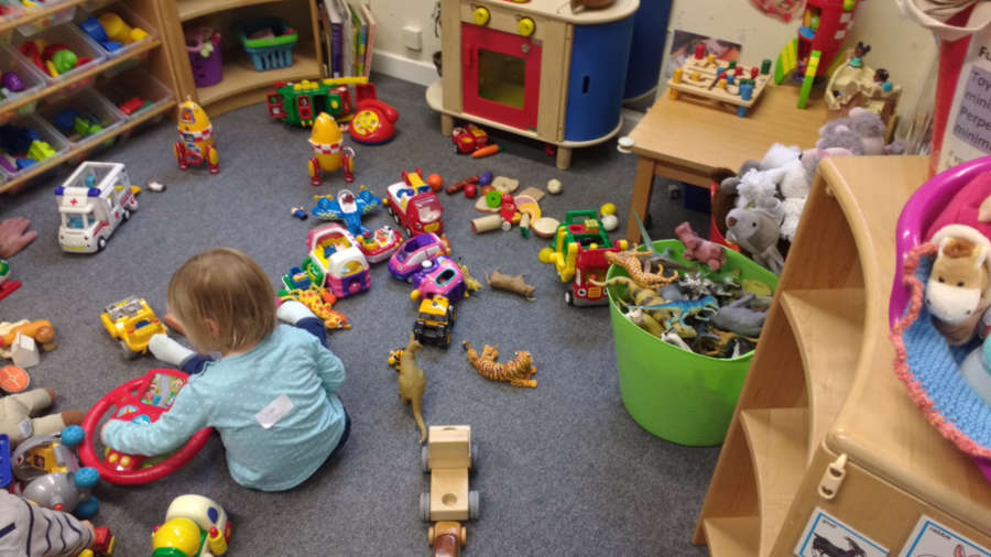 Child playing on the floor with toys